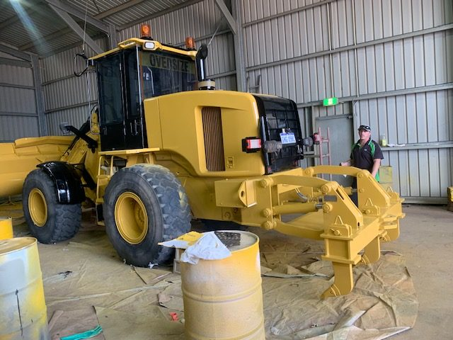 abrasive blasting and painting for heavy machinery